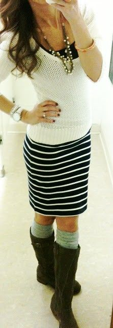 Flat boots with skirt.  Love this look and so comfy!