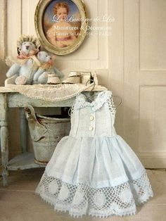 Romantic blue dress, Antic French fabric and lace, Collectible accessory for a dollhouse in 1:12th scale    Girls dress.  (6,5 cm 2.56 )    I made
