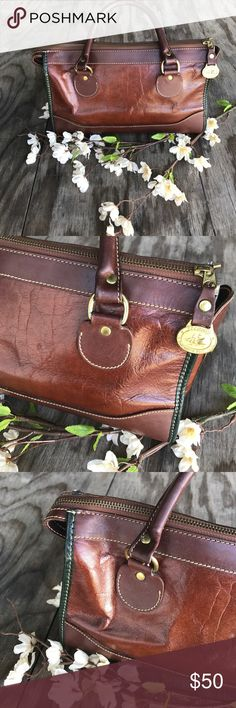 Classic Brahmin Mahogany Leather and Green Trim 12 inch width 7inch Length. This is an older bag so it does have ware and marks on the back and inside as pictured. This is a beautiful bag that is wearable and classic. Bags