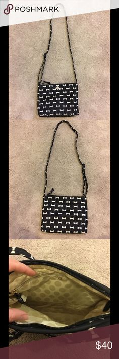 """Kate Spade Nylon Flatiron crossbody with bow print Kate Spade nylon crossbody with adjustable strap. Black with white bow print. Magnetic slip pocket on back, interior zipped pocket. Lightweight, used a handful of times (a little dirty on the bottom corners but hardly noticeable).  10""""w x 7.5""""h x 2""""d. kate spade Bags Crossbody Bags"""