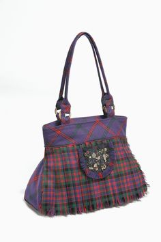 The kiltie bag. This modern Scottish look using real Scottish wool taking inspiration from the traditional Scottish kilt. plenty of room for everything you need.
