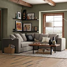 I really wish I could paint the walls in my home but alas it's a rental. This wall color just screams out to be applied to my living room walls. I have a gray couch in that exact shade and it's absolutely perfect.