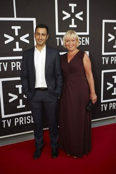 Danish TV news presenters Erkan Özden (b. 1978) and Tine Gøtzsche (b. 1967)