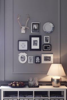 Add some dimension to your photo gallery wall display by incorporating other beautiful things like decorative plates and found objects.