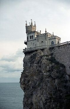 Palace Swallow's Nest; photograph by Tim Zizifus. Info from National Geographic: The neo-Gothic Swallow's Nest castle perches 130 feet (40 meters) above the Black Sea near Yalta in southern Ukraine. Built by a German noble in 1912, the flamboyant seaside residence now houses an Italian restaurant.... Been there, wish it was my house...