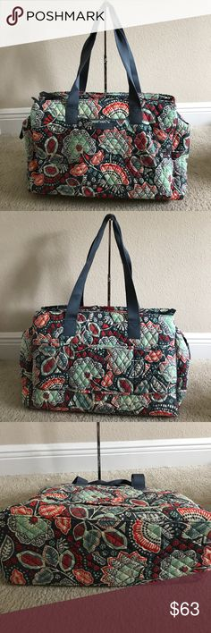 """VeraBradley Signature Print Triple Travel bag Vera Bradley Signature Print Triple Compartment Travel Bag. In great condition. Missing one zipper handle. As pictured. Color nomadic floral. Signature print, double handles, zipper closures, front slip pocket, two back slip pockets, trolley sleeve back compartment fits up to 15"""" laptop Measures approximately 18""""W x 13-1/2""""H x 7""""D with an 11-1/2"""" strap drop; weighs approximately 1 lb, 12 oz Face 100% cotton; fill/trim 100% polyurethane; lining…"""