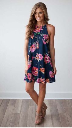 Adorable navy floral dress with pendant necklace and tan wedges