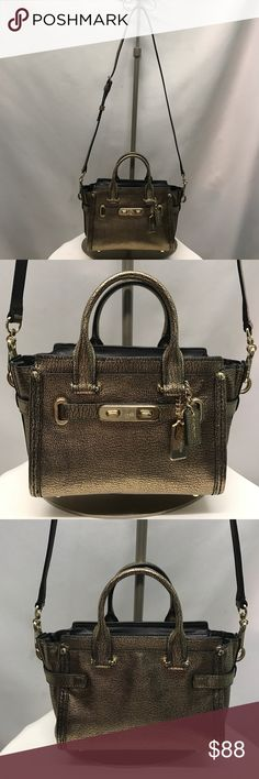 COACH purse This is the CUTEST little Coach purse I've ever seen. Gold and black crackled leather with gold hardware. This purse in in beautiful condition with no flaw. Two large open pockets inside. Coach Bags