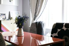 The table's shiny surface is easy to wipe down, making it an ideal spot for playing games, catching up on work, or hosting friends for cocktails and chat. And don't forget the throw, in case the air conditioner's going strong. Multi Banded Apex Vase by Robert Siegel Studio, Dots Luxe Throw by Kelly Wearstler.