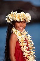Beautiful young girl wearing a plumeria lei...the fragrant smell of the islands!