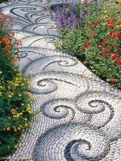 Walkway made of Pebbles home flowers garden path walkway yard pebbles