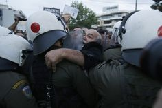 IT'S OVER: Riot police stormed the main premises of Greece's public broadcaster on Thursday in Athens, ending an almost five-month occupatio...