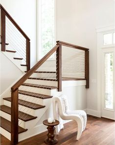 16 Creative Stair Railing Ideas To Develop a Focal Point in Your Home Stair railing decor matters. It can make or break the staircase's look. To help you style it, here we listed 16 stair railing ideas you must check out Cable Stair Railing, Modern Stair Railing, Staircase Railings, Modern Stairs, Staircase Design, Banisters, Staircase Ideas, Staircases, Staircase Remodel