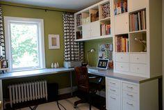 one full wall a desk/cabinet combo  IKEA- craft room organization idea