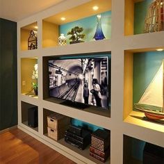 Showcase Built-In Bookcase Plans Construct a dramatic built-in bookcase and entertainment center with these simple plans. All you need is some inexpensive lumber and drywall. Bookcase Plans, Built In Bookcase, Bookcase Wall, Bookshelves, Built In Tv Wall Unit, Wooden Bookcase, Bookshelf Design, Wall Shelves, Built In Entertainment Center