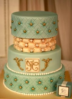 Ohh, I love the diamond tufting on this cake. And the colors are so retro and perfect. With the glints of gold and pearls, it's like a little jewelry box full of treasures!    Submitted by Crystal Q. and made by Andrea's SweetCakes