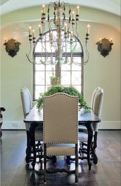 Pretty Os de Mouton lef chairs with nail heads and trim. Love the sconces too.