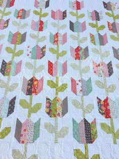 Tulip Market PAPER Quilt Pattern by Coriander Quilts Quilt Size: 68 x 83 Jelly Roll Friendly Quilt, Fabric Requirements listed in above photos Pattern #119 This listing is for the PAPER version of the Tulip Market quilt pattern. The pattern is a full color booklet style pattern with