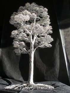 This rather large tree sculpture is made out of aluminum wire. The tree is all hand twisted and is held together by its own friction. Unique as this tree is, it could function as a center piece somewhere. The leafs exist out of aproximately 4500 loops. This piece took me about 80 hours