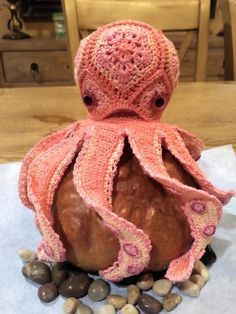 Wanted to make an African flower octopus and checked for a pattern. Alot of African flower animals but no octopus. This is my design and was fun to make. I think he would look great sitting on top of a gift wrapped with sea themed paper.