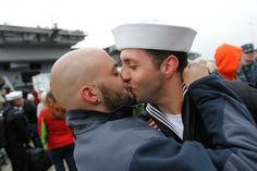 """Sean Sutton, left, greets his boyfriend of 2 years, U.S. Navy sailor Jonathan Jewell, E5, with a kiss after Jewell returned from a seven month deployment aboard the USS Stennis on Friday, March 2, 2012 in Bremerton, Wash. ""  <3"