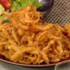 Daphne Oz's Shoestring Frizzled Onions (onion straws.. this is the recipe I've used for years + a lil sugar.. my 17yr old son is addicted to them)