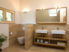 Cozy bathroom - model house R. Frammelsberger- Gemütliches Badezimmer – Musterhaus R. Frammelsberger Tiles in warm earth tones make the bathroom in … - Cozy Bathroom, Bathroom Hacks, Ideas Baños, White Wall Paint, Wooden House, Farmhouse Style Decorating, Model Homes, Contemporary Interior, Home Decor