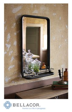 Perfectly industrial, this metal frame pharmacy mirror has a convenient shelf for displaying all of your vintage bottles. http://www.bellacor.com/productdetail/kalalou-cq6259-raw-metal-framed-mirror-with-shelf-1560766.htm?partid=social_pinterestad_1560766