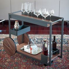 Cattelan Italia's Brandy Trolley has a classic and charming design that is still unforgettable. Bar carts are perfect for rolling out during parties and will stylishly cap off any dining room.