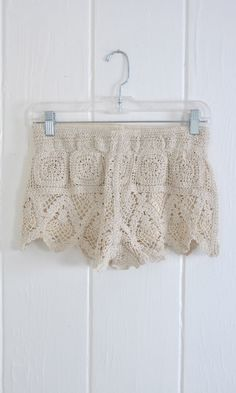 Inspiration only. I think I could master this! Some crochet thread & about 10 square-shaped motifs, then top it off with a few rows DC & DC Cross-Over & Ta-Da!.|crochet shorts|