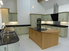 Large functional Broadoak Natural and Painted kitchen, these clients wanted the design to be visually impressive whilst being efficient and functional. See more images here - http://www.sncollection.co.uk/real-kitchens/real-kitchen-projects/broadoak-natural-and-sage-decor-kitchens-and-bathrooms.html