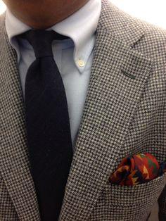 Light grey herringbone tweed jacket, light blue OCBD, navy tie, navy pants