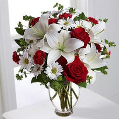 Beautiful arrangement of red roses, white asiatic lilies, white daisy spray chrysanthemums, mini red carnations and sprigs of bupleurum and salal are presented in a clear glass vase. Bunch Of Flowers, Types Of Flowers, Fresh Flowers, Lilies Flowers, Asiatic Lilies, Online Flower Shop, Send Flowers Online, Flowers Canada, Calla Lily Bouquet