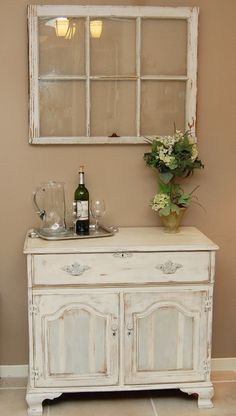 Cannot tell which I like more -- the rustic window pane or the off white cabinet.