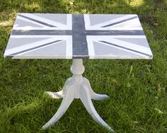 An old sidetable was first painted in Paris Gray before taping off the Union Jack design with Graphite and Pure White