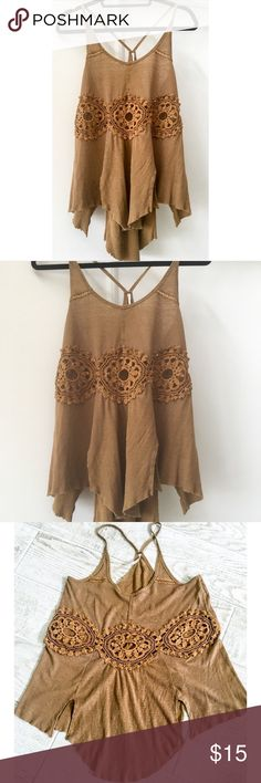 Free People top Cool Free People top with see through embroidered application in the front. Free People Tops Tank Tops