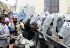From Bolivia, where riot police clashed with some wheelchaired protesters