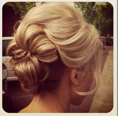 Wedding hair updo - cute love the backcombing at the front and the hair in the face