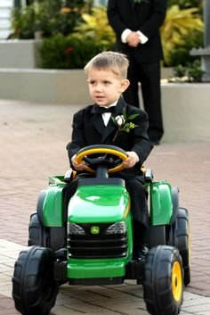 Ring bearer comes down the aisle on a mini tracker.
