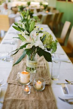 Get inspired: Who doesn't love a centerpiece that's minimalist but sweet? Go rustic with simply-bound flowers and candles!