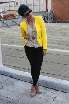 neon yellow jacket sheer nude blouse black pant and nude pumps