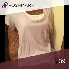 💐NWT THEORY PALE LILAC COTTN BLEND LAYERING TEE S Sooo PRETTY! NWT Theory thin layering tee shirt in pale lilac shade- wear with so many looks! 50% cotton 50% viscose. Has ability to stretch. Size small, but could work for medium . Original retail: $75. Great price ! Would look great layered with white, or shades of burgundy and greys. Deep scoop neck, short sleeves. Listing for theory tee shirt only💐 Theory Tops
