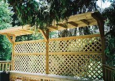 I love that the pergola look to the top of this privacy wall.  It would provide some shade in the afternoons on the patio.