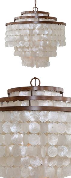 You're looking for a classic silhouette with an island twist? The Molokai Chandelier hits the magic number. Its layers of opalescent discs evoke the look of abalone, while a deep bronzed finish lends a...  Find the Molokai Chandelier, as seen in the Home Sweet Homesteader in Joshua Tree Collection at http://dotandbo.com/collections/home-sweet-homesteader-in-joshua-tree?utm_source=pinterest&utm_medium=organic&db_sku=118583