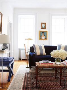 Brimming with a mix of styles and materials—from cabana-stripe silk to navy velvet to sleek acrylic—Amy's pre-prewar Manhattan apartment reflects her laid-back-luxe aesthetic. Photo by Tara Donne.