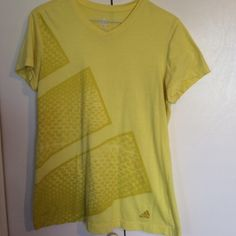 Medium Adidas athletic top - lime/yellow Bright yellow size M Adidas top. I love this top, it's just a little too big on me now. Some very light pilling and lettering is starting to wear off in lower left front corner. Otherwise in good shape and lots of life left! Adidas Tops Tees - Short Sleeve