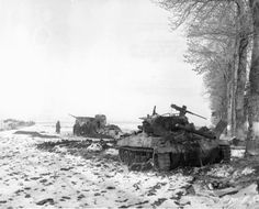 Destroyed American 76 mm Gun Motor Carriage (GMC) M18 Hellcat Tank Destroyer and M3A1 Halftrack in the background, lost to the German artillery fire near Bastogne, 29 December 1944.