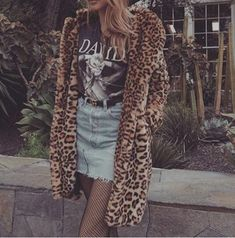 Leopard fur coat over jean denim skirt and graphic t Tomboy Fashion, Grunge Fashion, Fashion Outfits, Stylish Outfits, Cool Outfits, Leopard Print Coat, Millenial Fashion, Autumn Winter Fashion, Denim Jeans