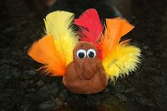 Perfect November playdough go-along! Make brown Thanksgiving playdough and serve it up with a basket of feathers and googly eyes for some creative turkey-making.