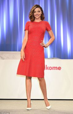 Kerr-nichiwa! Miranda opted for an eye-catching red dress at the Tokyo event...